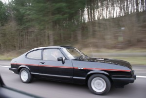 Ford Capri Mk3 in Black driving down the M6 at speed on the way to the NEC classic car show